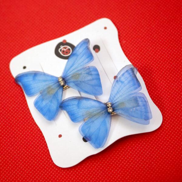 clame par fluture albastru